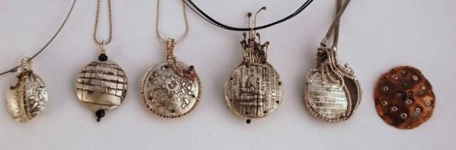 Mary Hettmansperger. Wish this pic was larger, these look interesting. Woven lentil beads and tendrils.