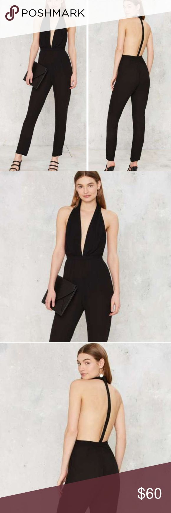 Black Pant Jumpsuit with Plunging V Neck Black pant jumpsuit features plunging neckline,  elastic waist, pockets, open racer back, tapered leg, partially lined. Polyester. I feel this runs a little small. I would recommend to someone XS. Inseam: 26 inches. Label haoduoyi Nasty Gal Pants Jumpsuits & Rompers