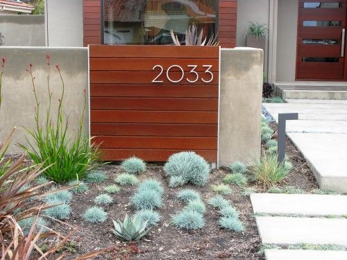 address - cute if you have a wall or low fencing around front yard. Could make from a pallet.