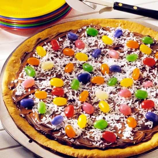 Easter Cookie Pizza        Colorful jelly beans mimic Easter eggs on this sweet take on pizza, with sugar cookie dough for the crust, chocolate frosting in place of sauce, and flaked coconut instead of cheese