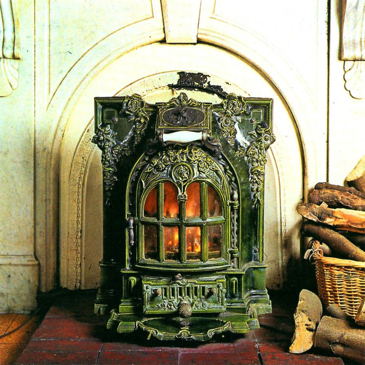 Antique wood burning stove by deville happy spaces for Decorative rocket stove