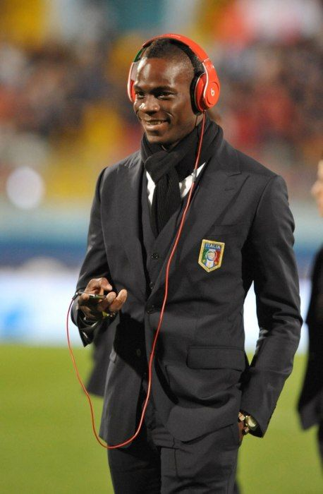 MARIO BALOTELLI Palermo native Mario Balotelli plays for both A.C. Milan and the Italian national team. Nicknamed Super Mario, the striker is known as much for his pitch-perfect skill as he is for his impulsive affect. More predictable than his behavior, however, is his wardrobe. Reliably on trend, Balotelli is most often spotted in leather jackets, distressed denim, and his signature cropped Mohawk.