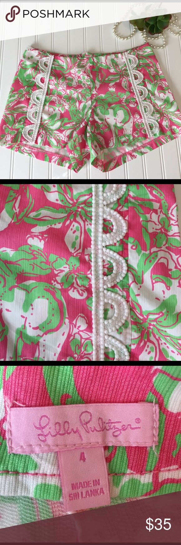 Lilly Pulitzer Shorts Gorgeous pink/green/white fabric with white cotton braiding on both sides of front.  For fit information see stock photo on model. Center hidden zipper in back.  Perfect condition.  From smoke free home. Lilly Pulitzer Shorts