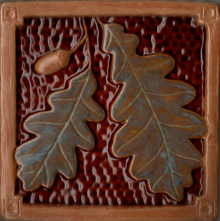 Love the rich earthy tones and reds, and the nature themes of this Arts & Crafts/Mission/Craftsman era. Fay Jones Day Tile - Oak Leaf and Acorn.