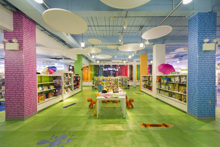 """IDL's Design, Engineering, and 3D Visualization teams collaborated to bring all the retail store elements together, which included all the floor fixtures, cash wraps and ceiling discs. Among the new additions is the """"Pick-Your-Pack,"""" a 40' wall that spans from floor to ceiling."""