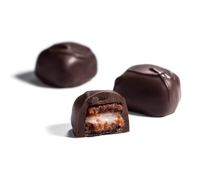 Quintessentially Australian. Dark Quandong. A fruit centre prepared from glaced Australian quandong with a layer of fondant cream then enrobed in dark chocolate.