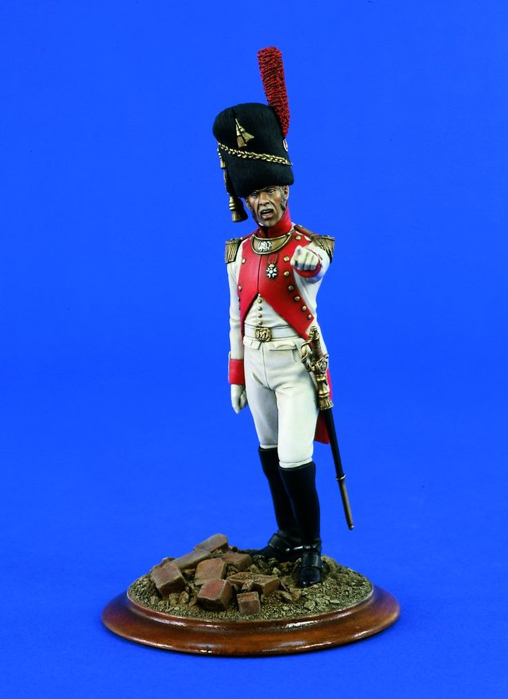 1812  Dutch Grenadier of the Imperial Guard - The Dutch Grenadiers became part of Napoleon's army following his 1810 annexation of Holland. At that time they were the Dutch Royal Grenadiers, and the men of this regiment entered Paris in August of 1810. Napoleon reviewed the troops personally and was very impressed by the fine appearance of the men. They wore white coats faced with crimson, instead of the traditional dark blue worn by other senior regiments.