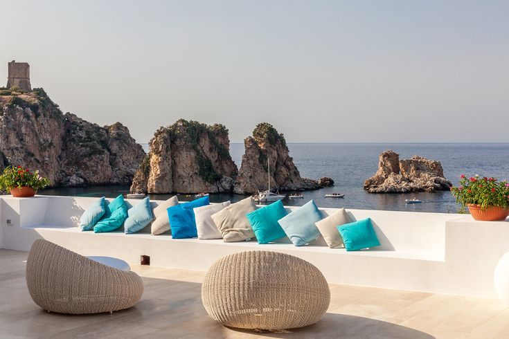 Ai Faraglioni - A unique, privileged seafront position for this refurbished modernist villa with infinity pool and garden gate access to the transparent waters below. #villa #Scopello #Sicily #holiday #travel #TheThinkingTraveller