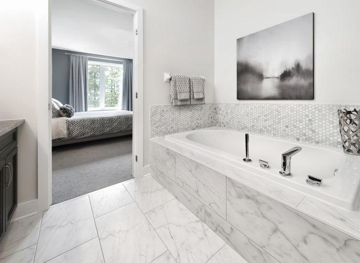 This is the ensuite bathroom in the Marigold semi-detached bungalow model home in Tartan's Russell Trails community.