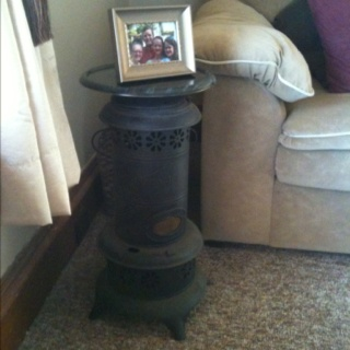 Old kerosene stove with small lazy Susan mounted on top and used as a end table!!!: Kerosen Stove