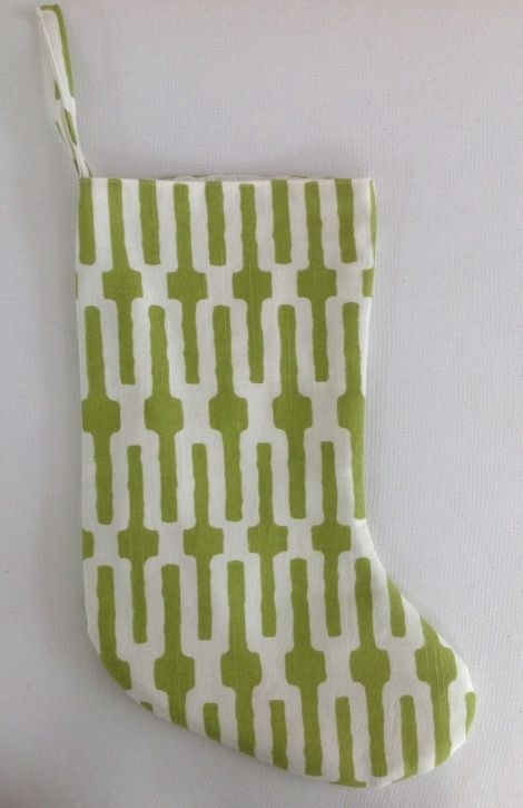 A vibrant, summer Christmas stocking to delight Father Christmas! Made in Wellington, NZ from a lovely lime green and ivory linen/cotton mix and fully lined with ivory cotton duck cloth. Dimensions - width (when flat): 20.5cm; length (top to heel): 31cm; length (heel to toe): 27cm; hanging loop: 18mm x 12cm drop.
