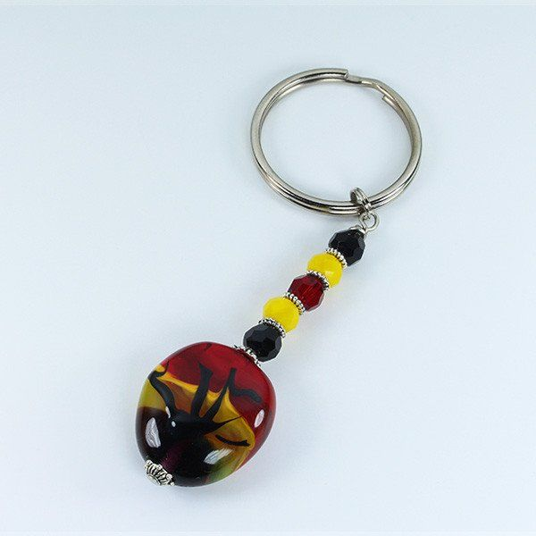 A handmade Murano glass bead African Sunset keyring is a nice affordable addition to your shopping basket. Choose the one that best matches your bracelet, necklace or earings.