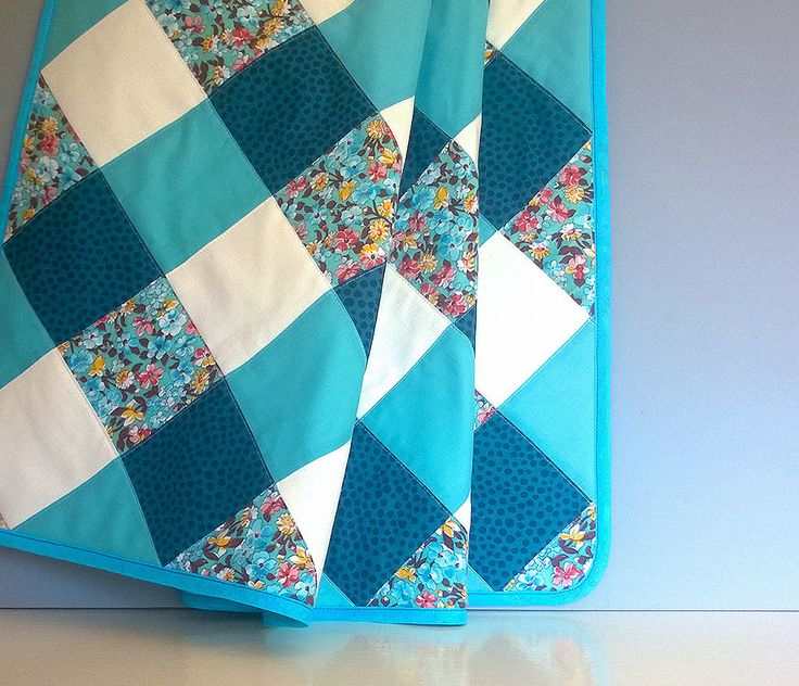 Baby cot quilt, handmade with gingham style patchwork, in gender-neutral blue, white and turquoise flowery cotton fabrics by annascupoftea on Etsy https://www.etsy.com/listing/236718313/baby-cot-quilt-handmade-with-gingham