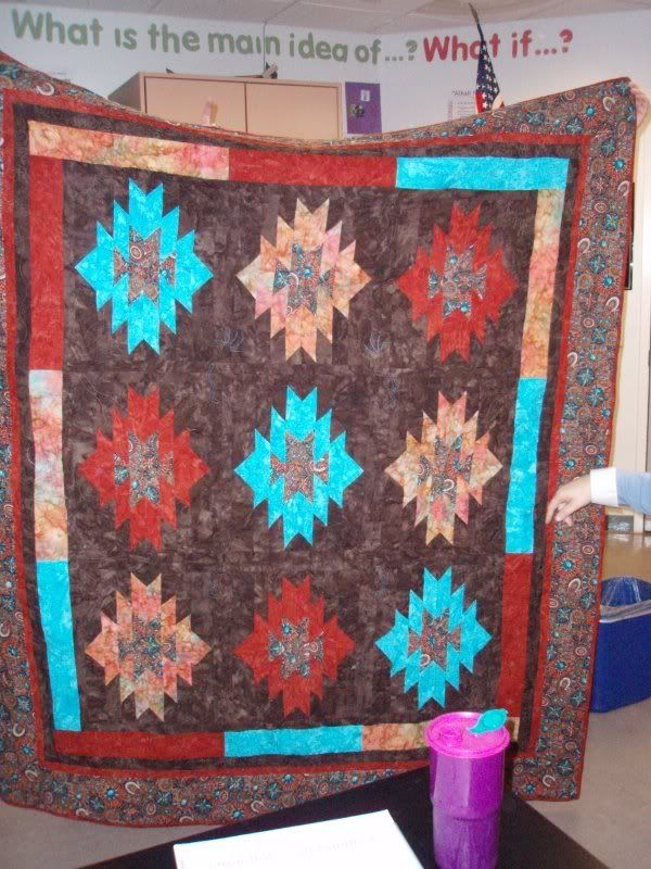 I love the colors in this quilt.  All that rich brown, turquoise and rust are just so warm looking.  This a a class project.  I even d...