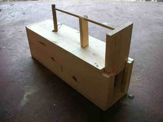 Free live trap plans for building a box trap to catch rabbits, squirrels and other small animals.  Includes step by step instructions and pictures.