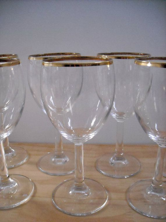 8 gold rimmed wine glasses, eight gold band goblets on Etsy, $50.00