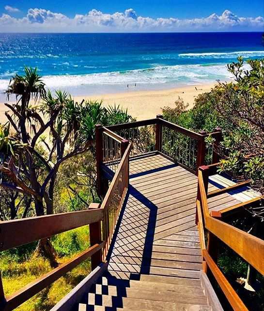 What an inviting set of stairs! You'll find these in the coastal village of Sunshine Beach, just a 5-minute drive from Noosa Heads. Once known as Golden Beach, Sunshine Beach is renowned for its sand, surf and the ambiance of its stylish boutiques, cafes and restaurants.