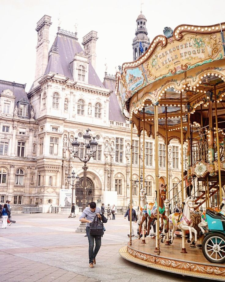 carousels in Paris France: a complete guide to finding merry go rounds in the city of lights. Trocadero, Hotel de Ville and more iconic sites!