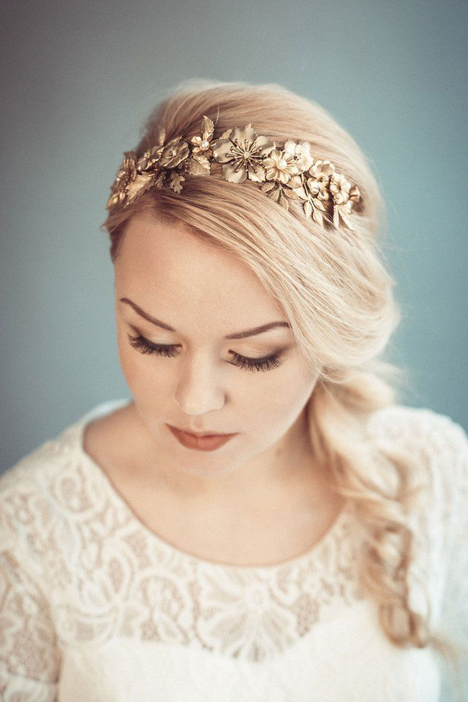 Gold bridal headpiece features pretty many vintage style leaves and flowers. Flowers centers decorated with swarovski pearl beads and golden plated rhinestones.