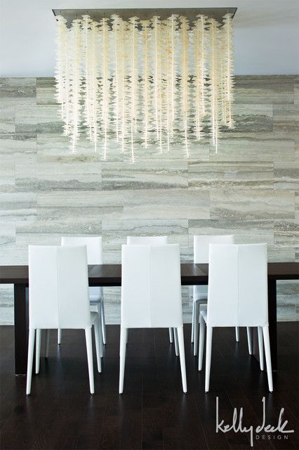 Dining room with vein cut stone tiled wall  The dining room features a  contemporary black. 429 best Dining Rooms images on Pinterest   Dining rooms  Island