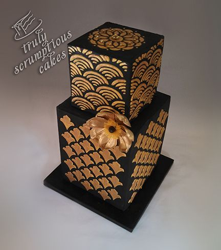 very unique black & gold square cake