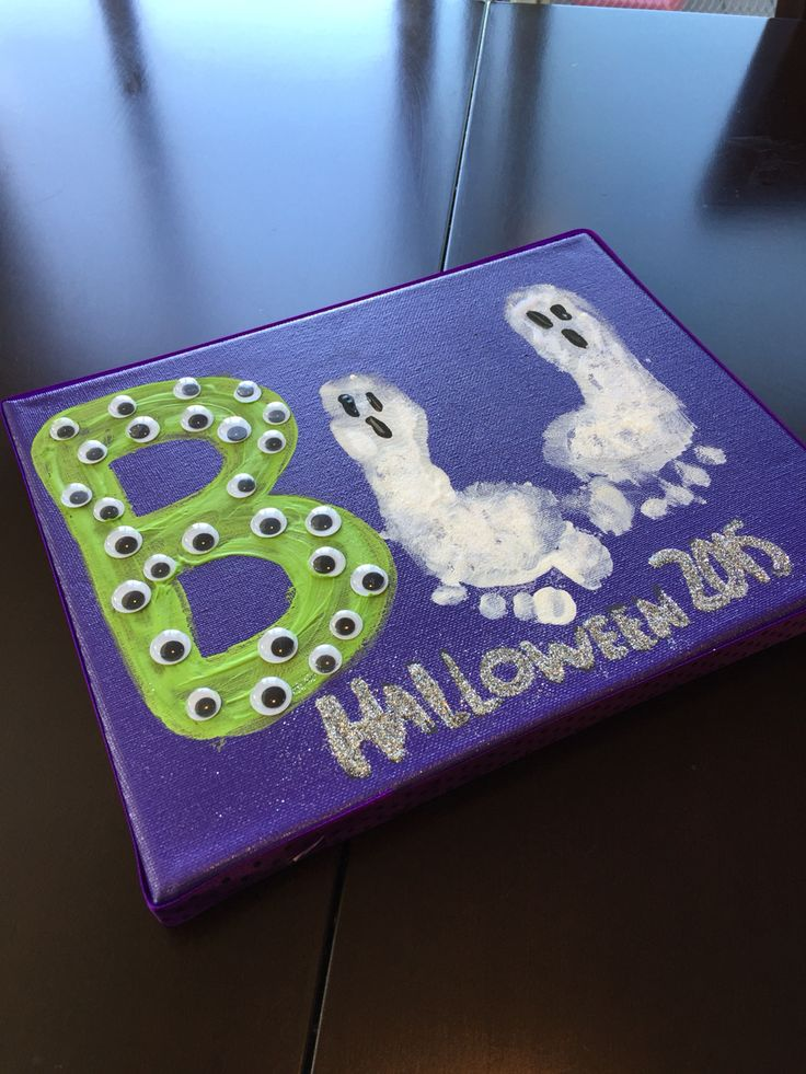 Just another Halloween craft for some toddler fun! I've seen lots of cute ways to use footprints and handprints for ghosts or spiders. This was our take on it.   My two year old was able to help glue on the googlie eyes too! Added lots of glitter and ribbon on the outside of the canvas to finish it off.