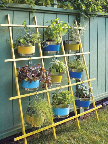 VERTICAL HERB GARDEN! Hang buckets with 'S' hooks.