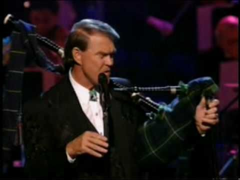 Glen Campbell  - Amazing Grace (Live).  Amazing!  Words cannot describe.  Musical genius.