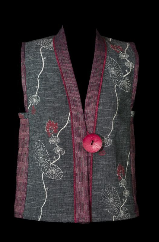 This simple vest was created from just two weighty cottons from Mekong River Textiles plus a little bit of quilters cotton for the accent piping. The directions for making a Tabula Rasa Vest are i…