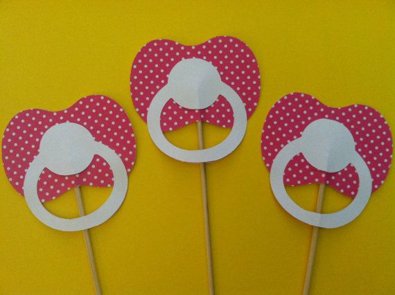Instead of on sticks. Hole bunch a hole in the middle and push a bendy straw threw the front. When your guests sip on their drink it will look like they are sucking on the pacifier!