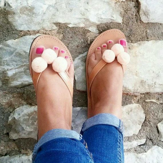 Peach fabric pom pom flip flop sandals with genuine High Quality Greek Leather. The leather is in natural colour and will darken after time. Rubber