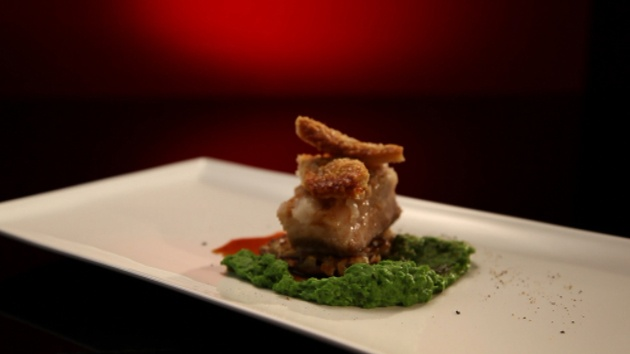 Slow-cooked pork belly with green pea purée and potato rösti