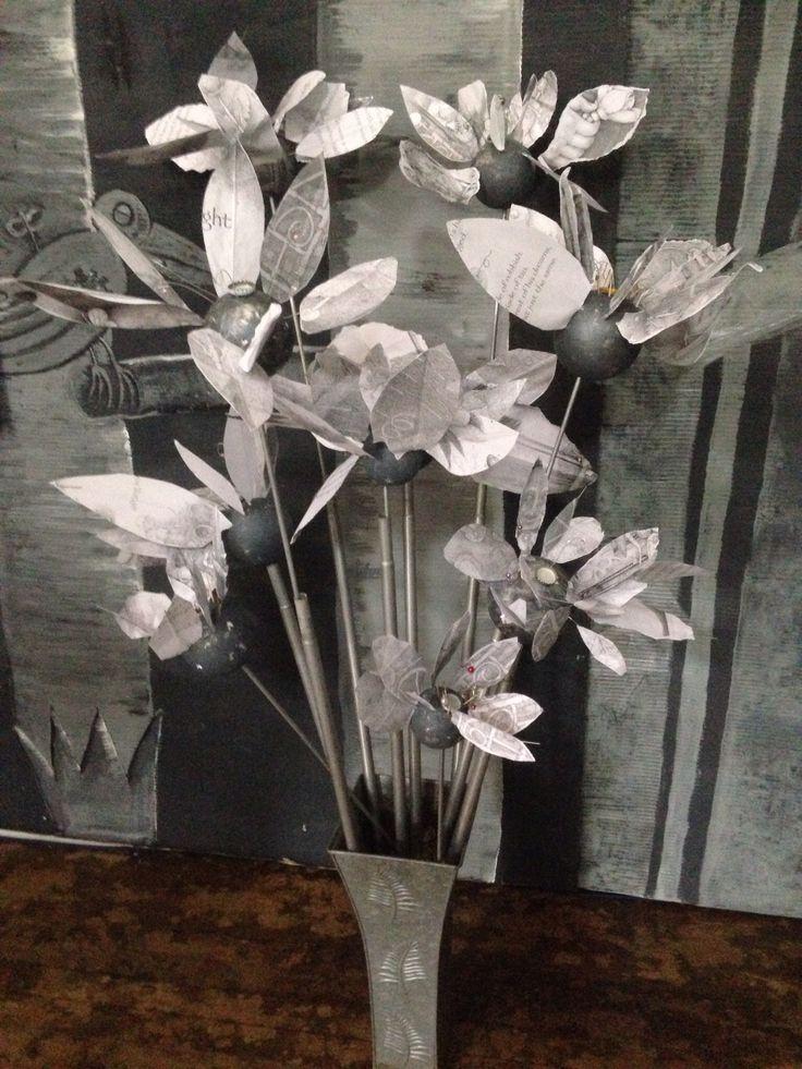 Tin flowers created by Year 6 alongside the high school.