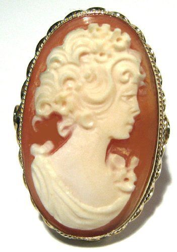 Cameo Ring Master Carved Conch Shell Sterling Silver 18k Gold Overlay Size 8.5 cameosRus. $131.00. Size 8.5  ITALIAN,  1.06 x 0.71 inches,. Beautiful, Carnelian Conch Shell, Reflection of Youth, Cameo Ring,. 925 Sterling Silver, 18k Yellow Gold Overlay, Master Carved,. Artisan Jewelry, Exceptional Value, great gift,. The Ring is Huge, Collector's Item, Bas Relief, Exceptional Value,