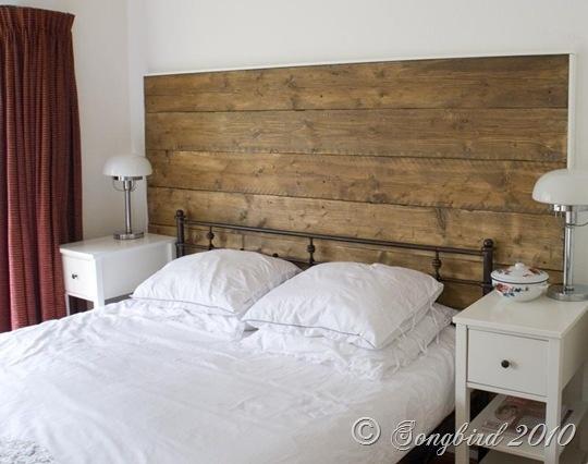 DIY-wood plank floors used as headboard.  Maybe paint white vintage finish
