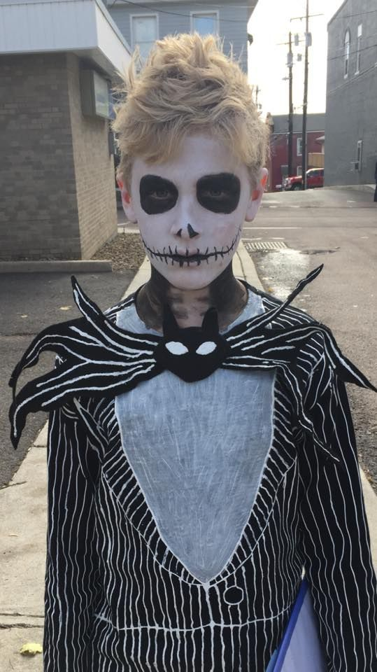 Jack Skellington.  Black T-shirt and Black pants, with painted white stripes (puff paint).