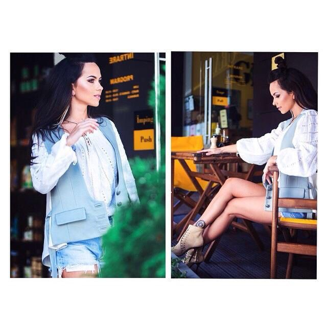 Inna,wearing a light blue vest with jeans shorts and a cute white Romanian traditional blouse!love her style!