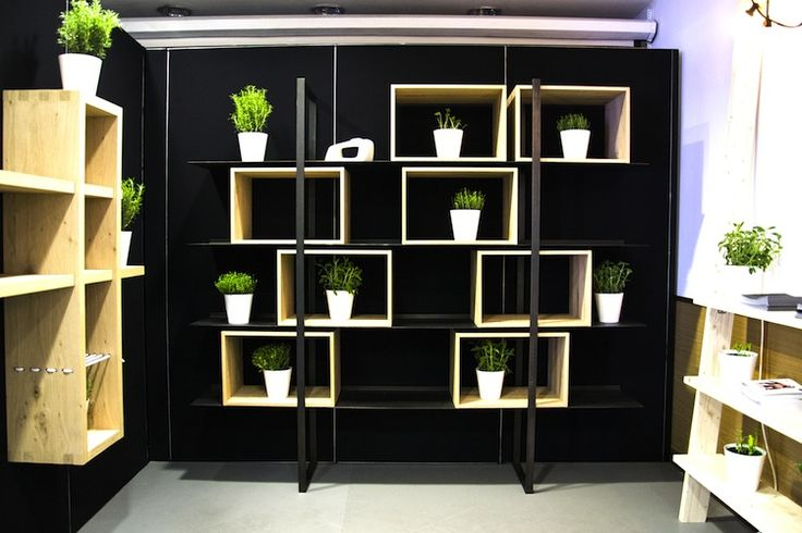 "Materials and geometry unite to give a sense of suspension to the objects placed on the metal shelves. The same concept of apertures and visibility also applies to the use of open wooden #storage units. FREEDOM gives the opportunity to ""juggle"" with the metal #shelves and wooden storage units, which can be placed where desired to create staggered or symmetrical arrangements."