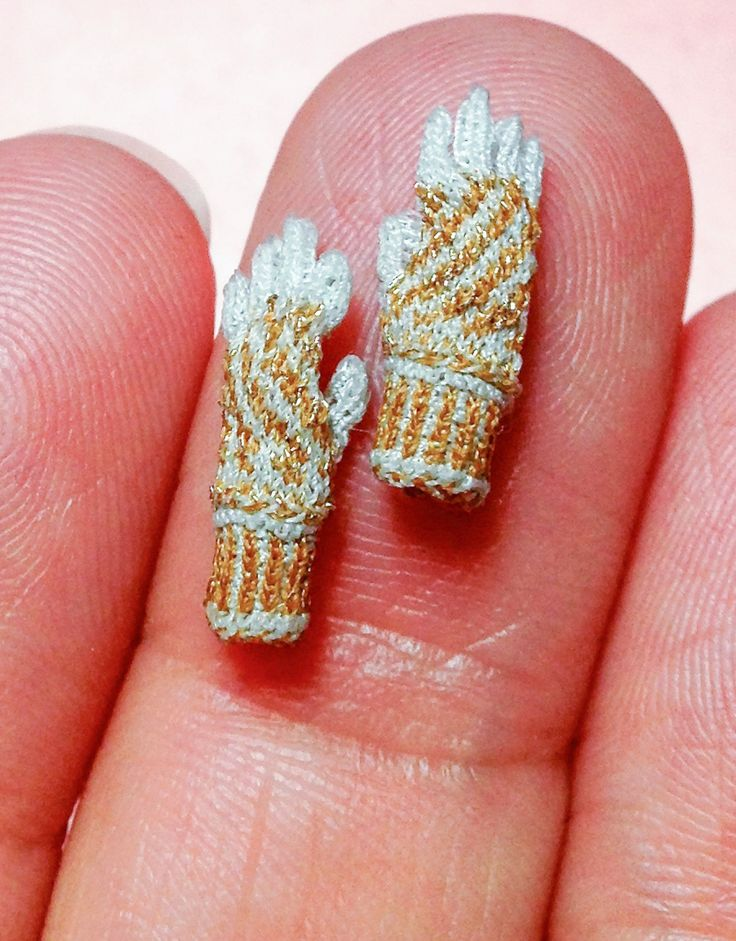 Althea Chrome spends hours carefully stitching microscopic garments such as gloves and jumpers, that'd definitely fit a member of the Sylvanian Family.  The garments, which come smaller than a fingernail, are designed using an exceptionally tiny needle and a 10 strength magnifying glass.