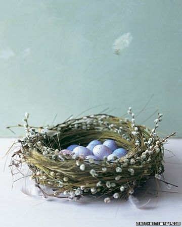 This time of year, birds instinctively put the materials at hand to good use. Here, the downy, gray catkins of pussy-willow branches soften a densely woven nest, while dried grasses inside cushion fragile decorated eggs.