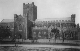 Christ Church Cathedral as it appeared before Street's restoration of 1871–8. The long choir (to the right) and the squat crossing tower are strikingly different than they appear today.The 14th century long choir was demolished during restoration works in the 1870s.