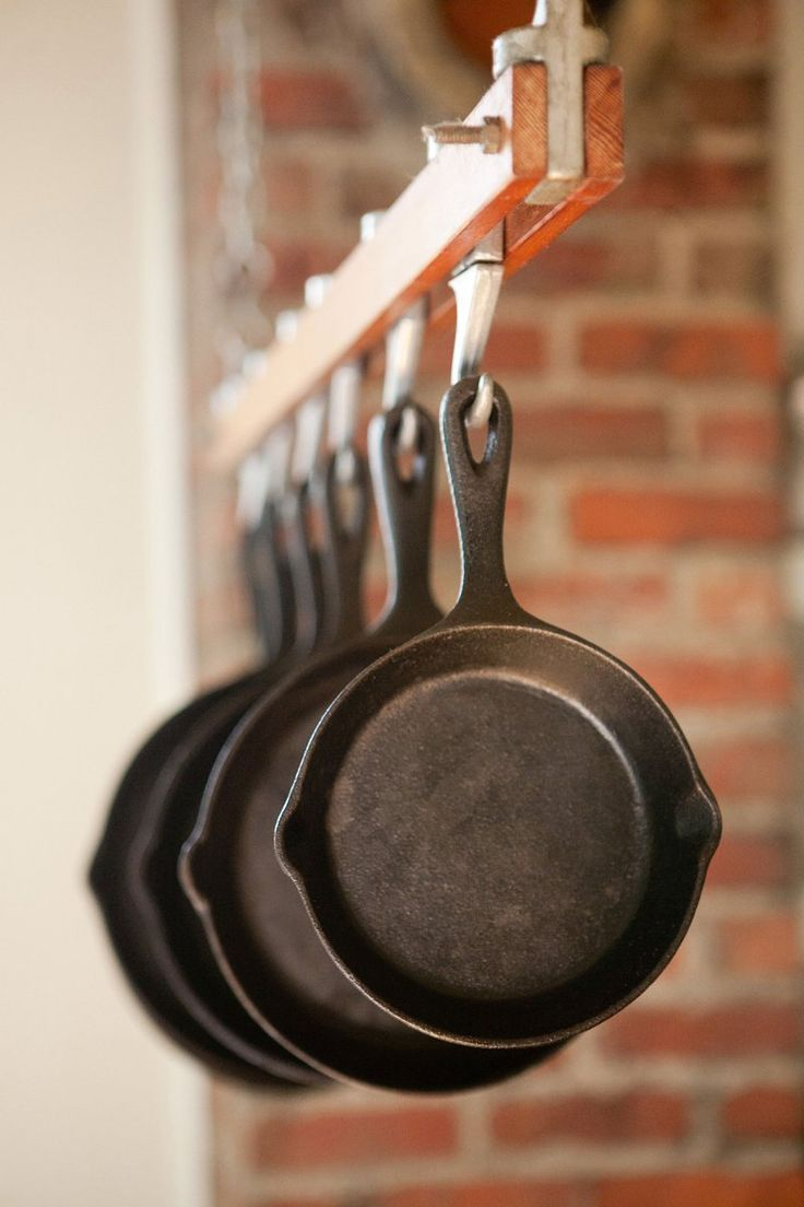 My three cast iron skillets are my most-used kitchen items. One of the skillets used to belong to my grandmother, which means the interior is super smooth (great for eggs). Because I use them so often, I keep my pans right on my stovetop, but that's certainly the least exciting way to store them, as evidenced by the setups in these 10 kitchens:
