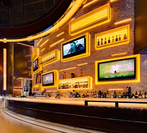 check out how they integrate TV within bar (possibly for basement if needed)