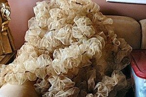 Gathered Tulle Garland tutorial. Great for the Christmas tree, and super cheap.