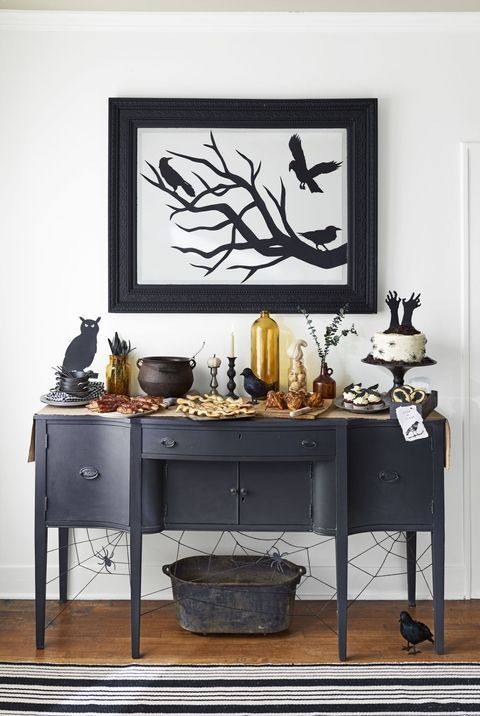Add Some Shadows: The entryway mirror is the perfect starting point for party decorations. Click through for more DIY Halloween decorations that will spook up your home!