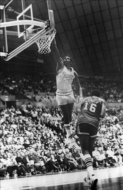 Spencer Haywood dunks on Bob Lanier.