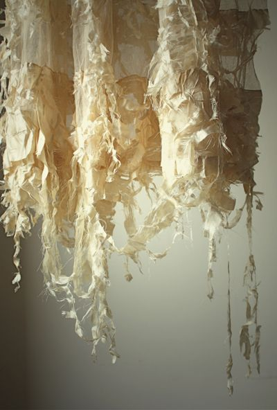 wonderfully tattered and incredibly fragile antique dress.All the silk is shattered, but beautifully shattered – almost as though it's transforming itself.