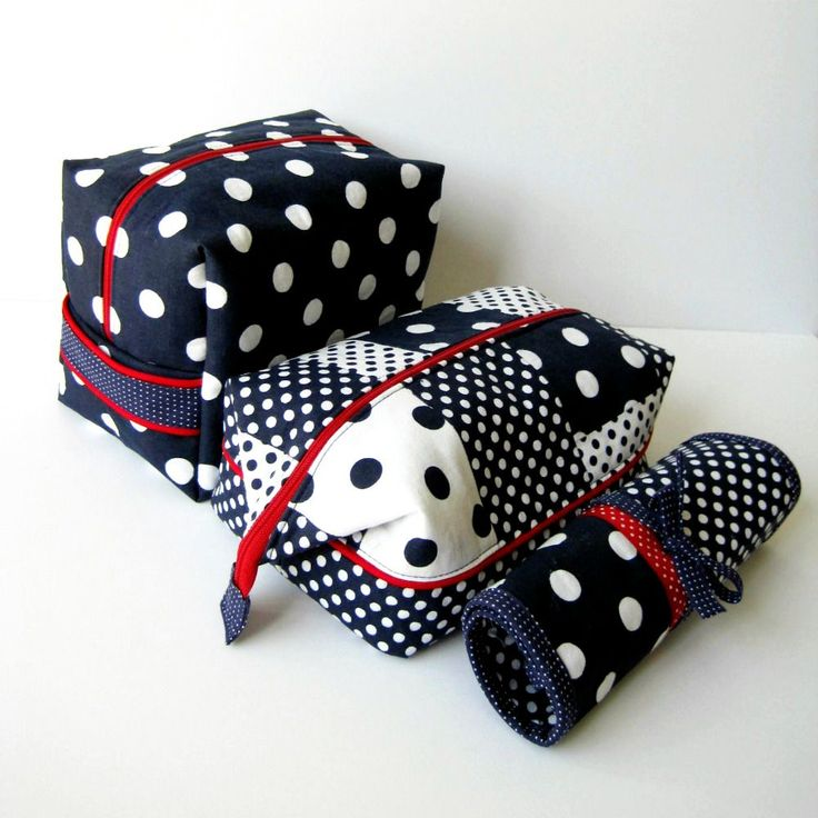 three different sized and style travel cosmetics bags