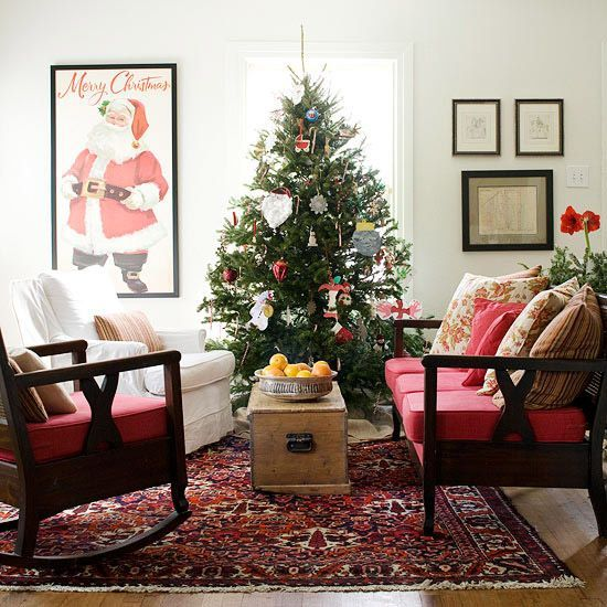 The #Christmas tree acts as the focal point in this living space. More #holiday living rooms: http://www.bhg.com/christmas/indoor-decorating/pretty-christmas-living-rooms/