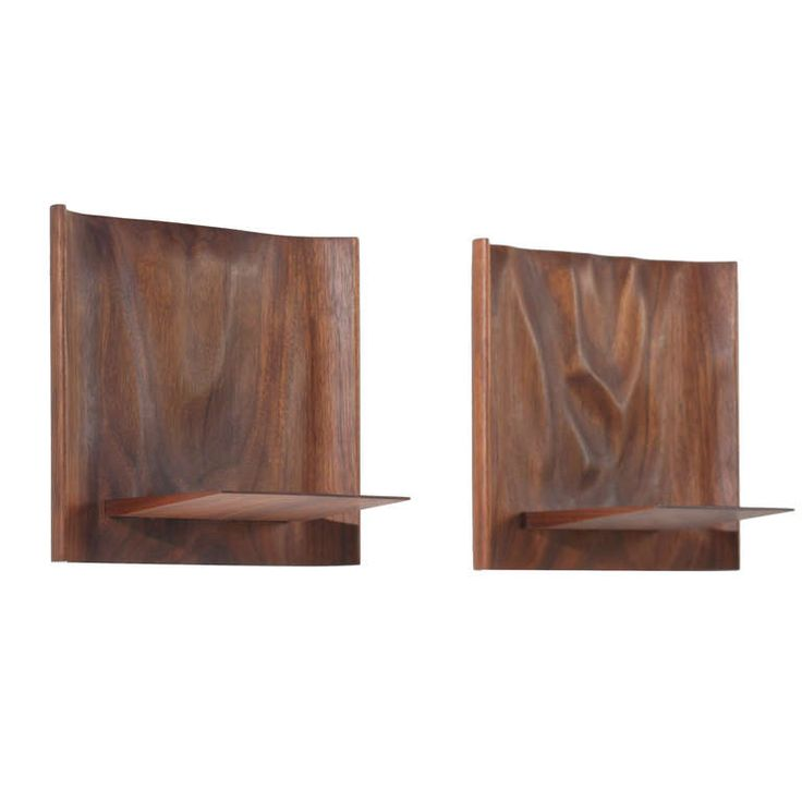 Pair of Sculptural Wooden Wall Shelves by Roger Sloan | From a unique collection of antique and modern shelves and wall cabinets at http://www.1stdibs.com/furniture/wall-decorations/shelves-wall-cabinets/